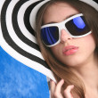 Young woman in striped hat — Stock Photo #1415876