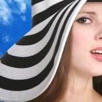 Beautiful girl in striped hat — Stock Photo #1415883