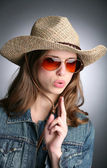 Cowgirl with imaginative gun — Stock Photo