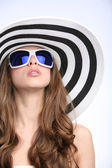 Glamourous girl in striped hat — Stock Photo