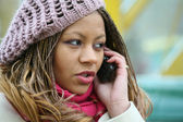 Woman is talking on mobile phone — Stock Photo