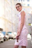 Brunette in white-rose dress — Stock Photo