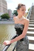 Luxurious brunette on bridge — Stock Photo