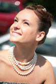 Smiling girl with pearl necklace — Stock Photo