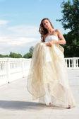 Beautiful bride in golden dress — Stock Photo