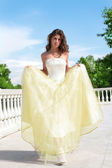 Beautiful princess in white-golden gown — Stock Photo