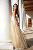 Princess in golden gown in gallery — Stock Photo