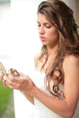 Bride look at the gift — Stock Photo