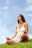 Pregnant woman is meditating — Stock Photo