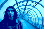 Long-haired men in blue tunnel — Stock Photo