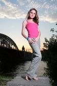 Barefoot girl on the riverside — Stock Photo