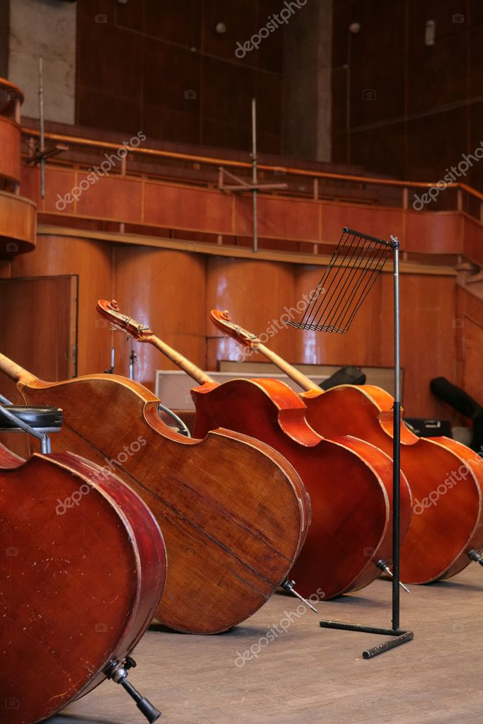 Vintage, music instruments, four old bass viols with copyspace — Stock Photo #1410441