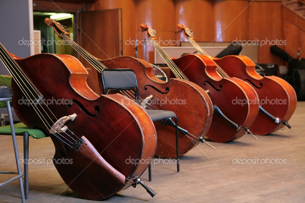 Vintage, music instruments, four old bass viols — Foto Stock #1410489