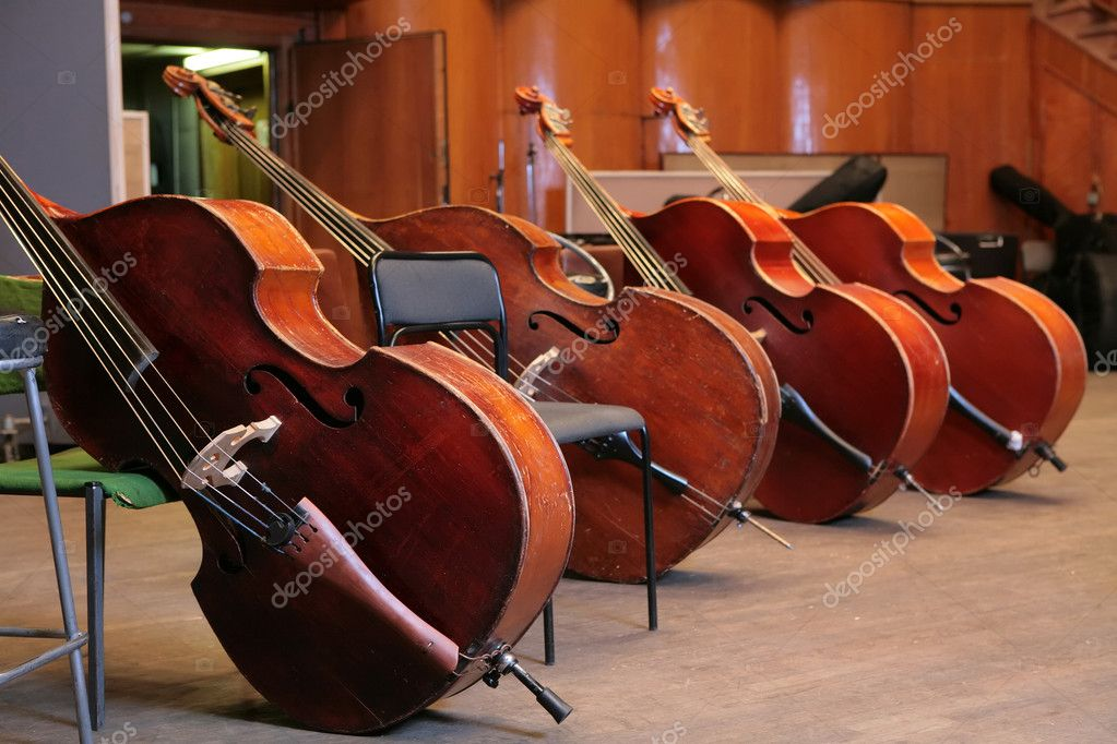 Vintage, music instruments, four old bass viols — Stok fotoğraf #1410489