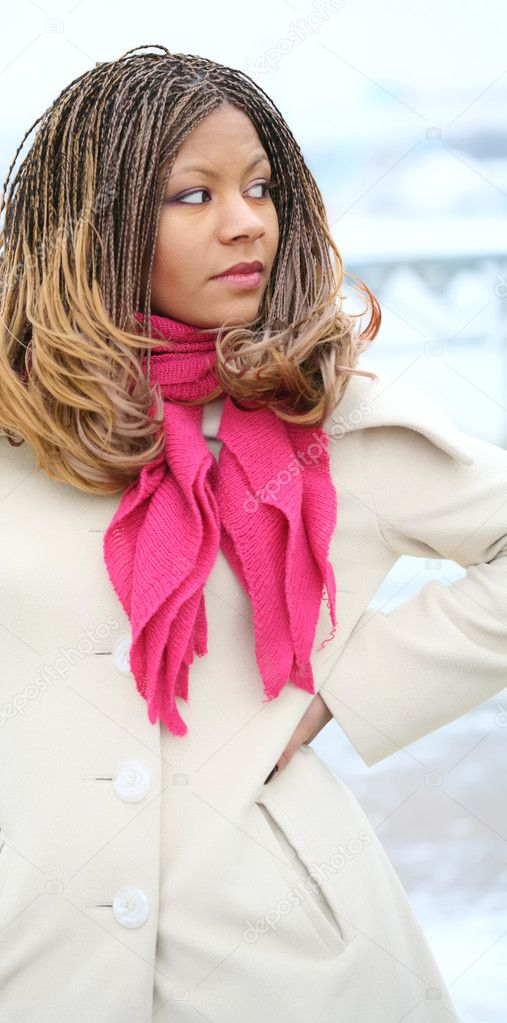 Beautiful black girl with exotic hairstyle in white coat with red scarf — Zdjęcie stockowe #1413719