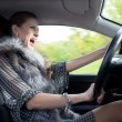 Woman yells in car - Stock Photo
