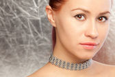 Beautiful woman with choker — Stock Photo