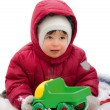 Little kid in the red winter jacket — Stock fotografie