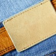 Jeans with blank label - Stok fotoğraf