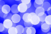 Defocused holiday lights — Stock Photo