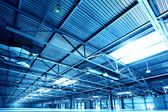 Empty warehouse toned in the blue color — Stock Photo