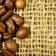 Coffee beans on sacking — Stock Photo #1190097