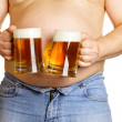 Man with two beer mugs — Stock Photo