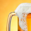 Beer mug with froth — Stock Photo