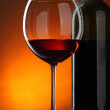 Glass and bottle of red wine — Stock Photo #1192639