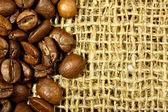 Coffee beans on sacking — Stock Photo