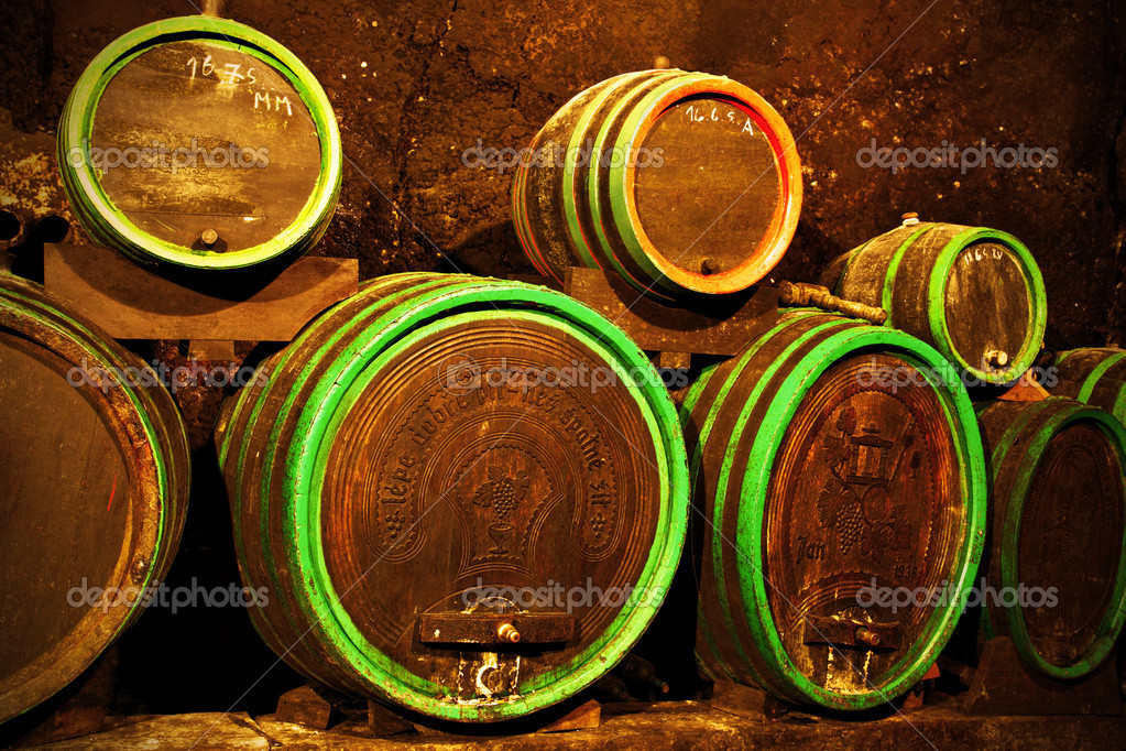 Wine barrels at cellar in a row — Stock Photo #1191727