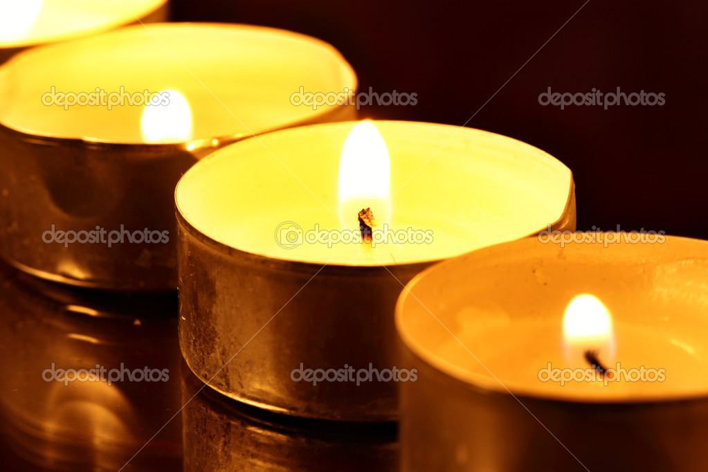 Burning warm candles close-up on a table — Foto de Stock   #1192352