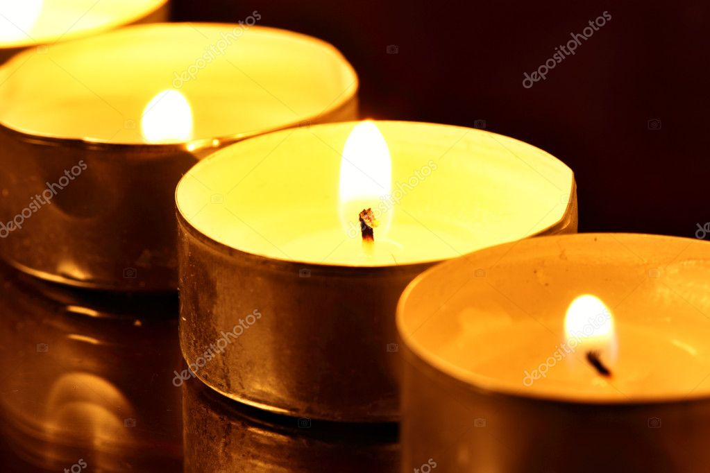 Burning warm candles close-up on a table  Stock Photo #1192352