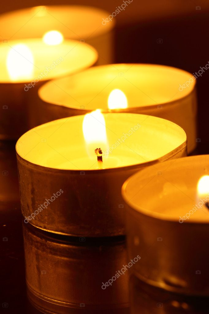 Burning warm candles close-up on a table — Stock Photo #1192379