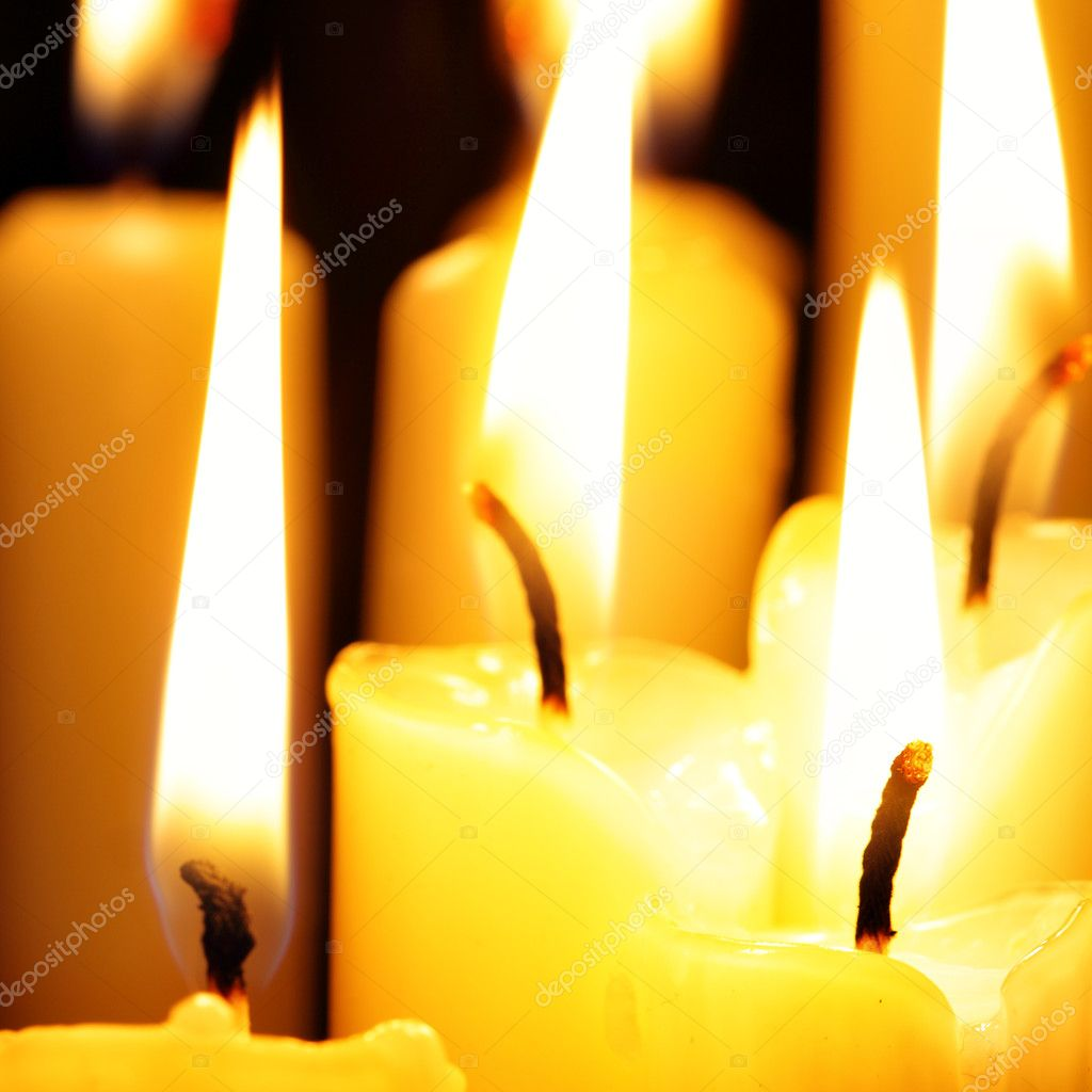 Burning candles close-up over a black background — Stock Photo #1192483