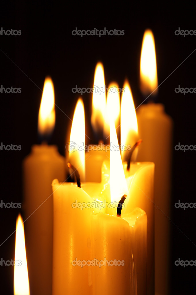 Burning candles close-up over a black background — Stock Photo #1192507