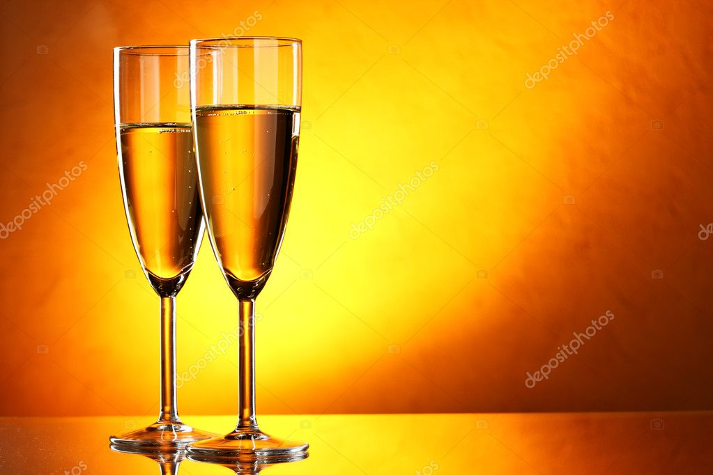 Couple glasses of champagne over yellow background  Stock Photo #1192573