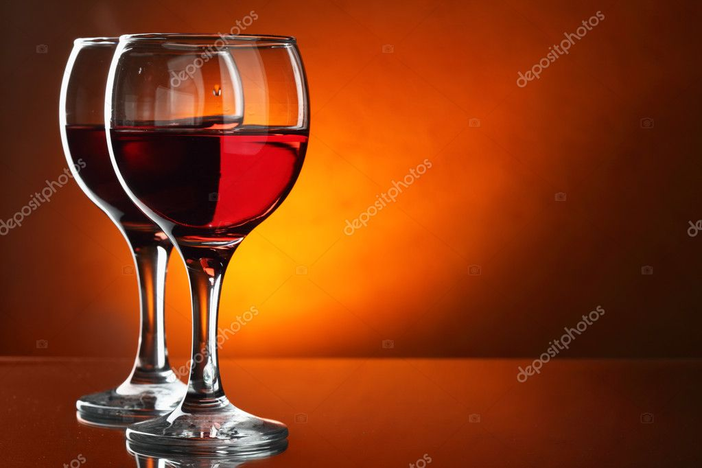 Two glasses of red wine close-up over red background — Stock Photo #1192597