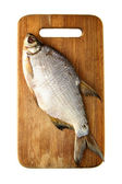 Fish on chopping board — Stock Photo