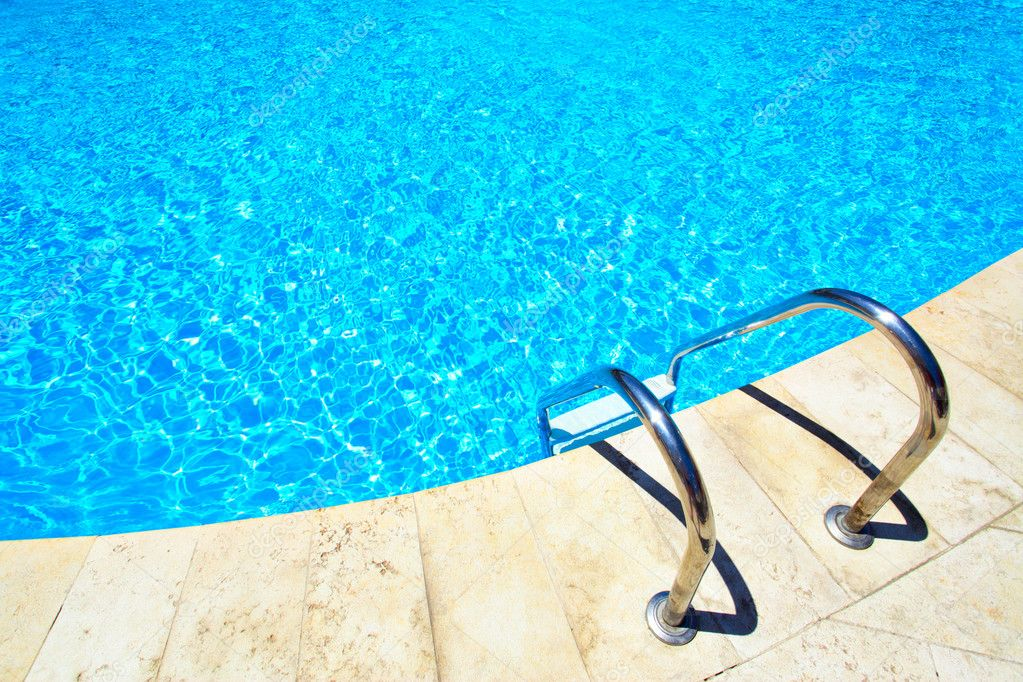 Swimming pool with stair at hotel close up — Стоковая фотография #1417863