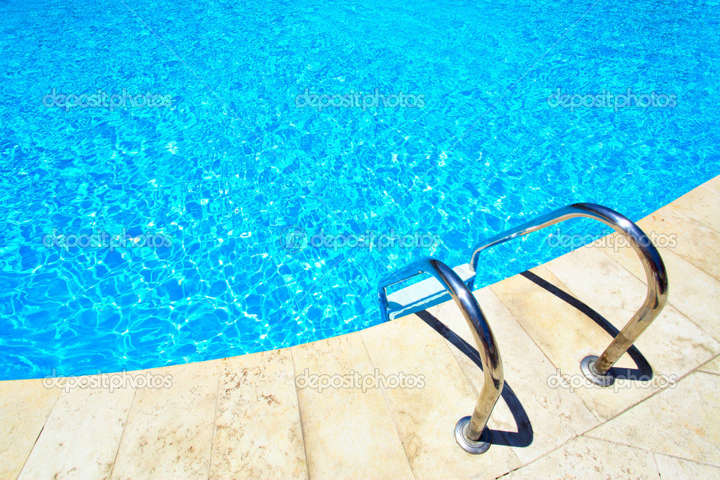 Swimming pool with stair at hotel close up — Foto Stock #1417863