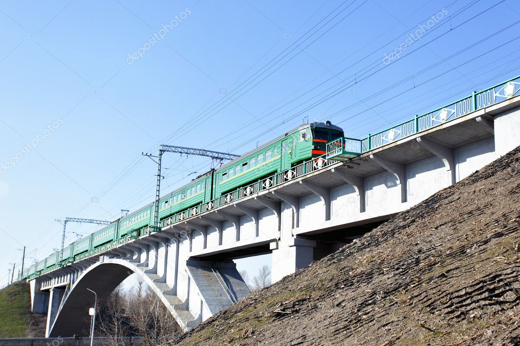 Suburban electric train drive on the brige — Stockfoto #1418511