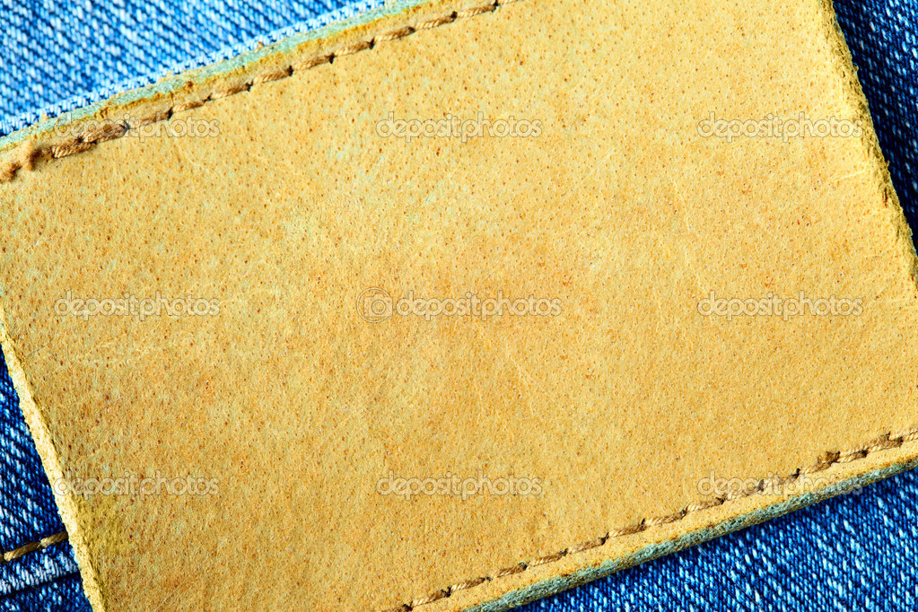 Jeans with blank leather label for your own text — Stock Photo #1419065