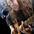Royalty-Free Stock Photo: Guitarist smoking cigar