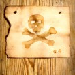 Paper with skull and crossbones — Stockfoto