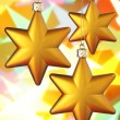 Three gold Christmas stars - Stock Photo