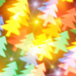 Blurred Christmas tree and stars - Stock Photo