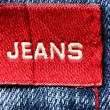 Jeans with red label — Stock Photo