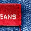 Royalty-Free Stock Photo: Blue jeans and red label