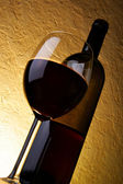 Wineglass and bottle of red wine — Stock Photo